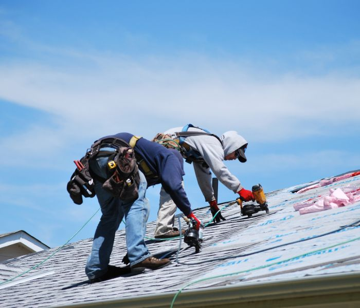 Roofers repairing a roof in Topeka, KS